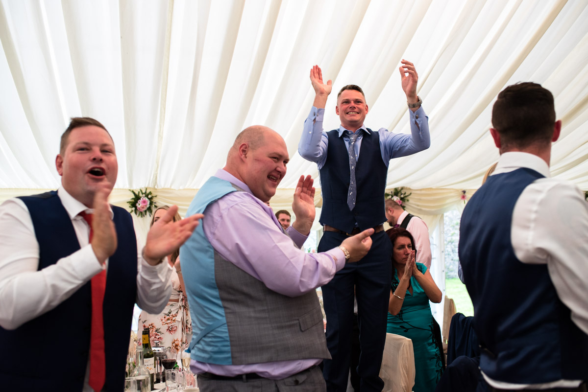 Photograph of Paul and Lexy's wedding guests at their Kent wedding at Allington Castle