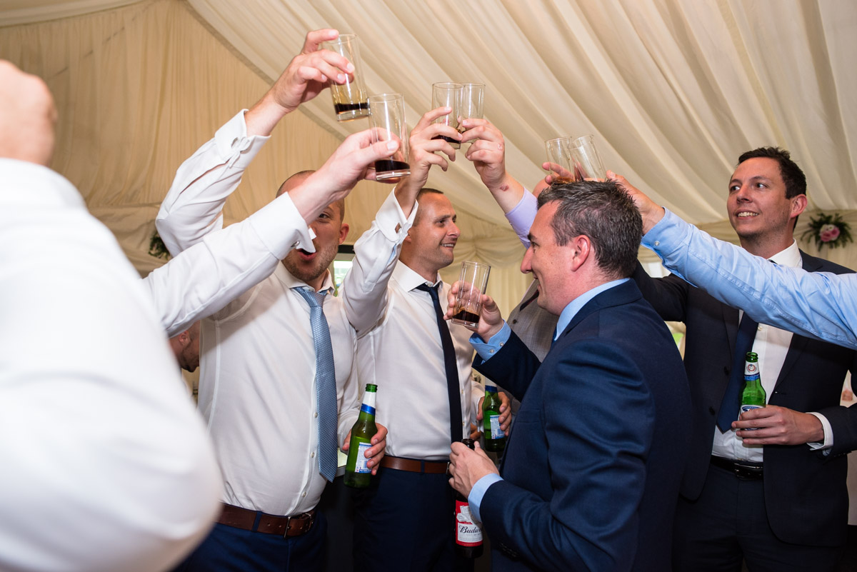 Paul and his friends celebrate with drinks on his wedding day in Kent