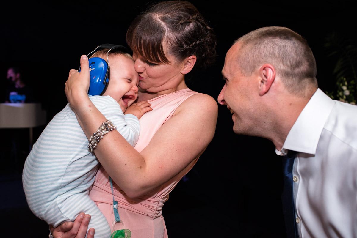 Baby Hugo wears ear protectors during the wedding dance