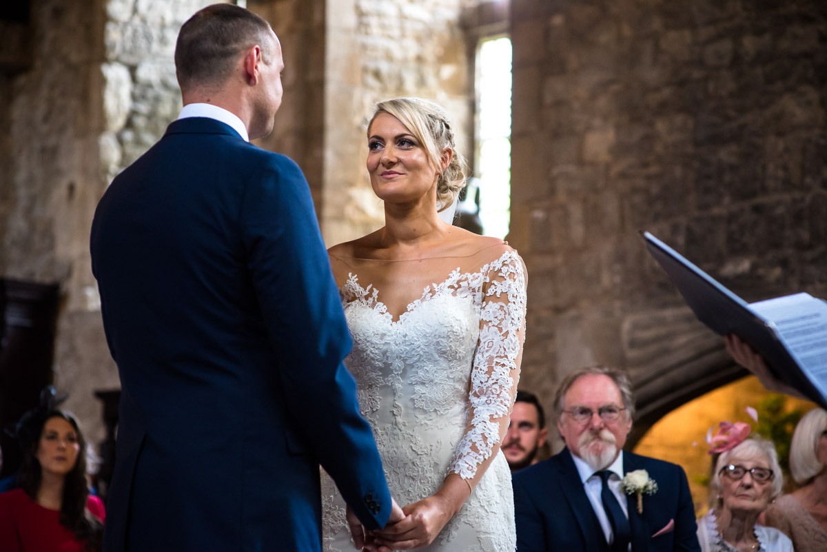 Sexy looks at Paul during their castle wedding ceremony in Kent