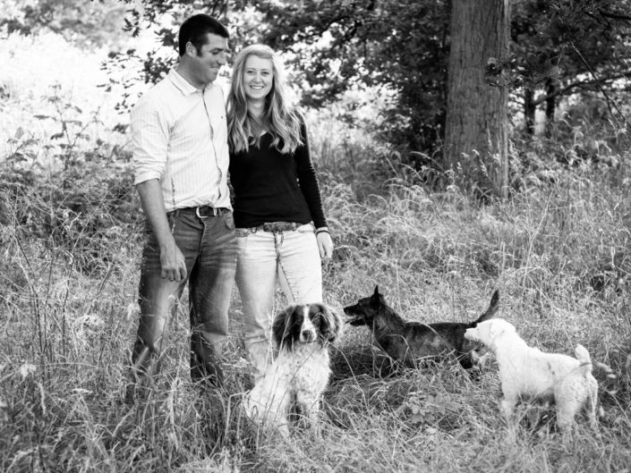 Pre wedding photograph of Becky and Kif with their dogs in their farm woods in Marden, Kent