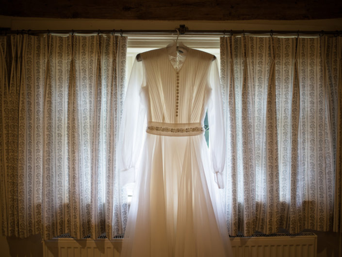 Backlit photograph of Jane's wedding dress taken at her parents home in Chilham, Kent