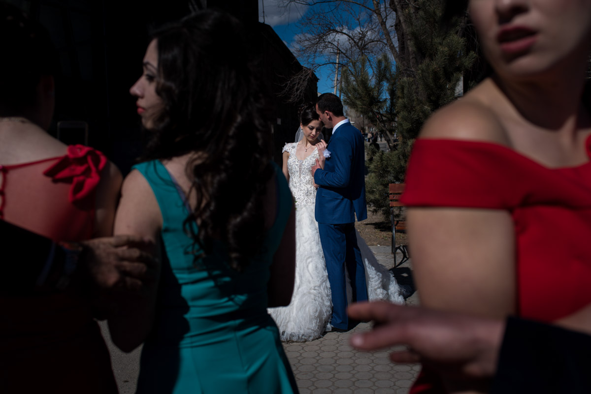 outside church in gyumri in armenia bride and groom are photographed after their wedding