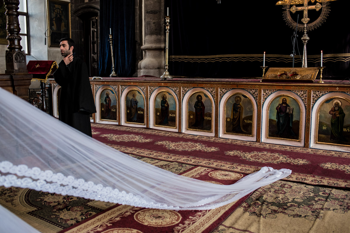 photograph of brides veil in armenian church during her wedding ceremony