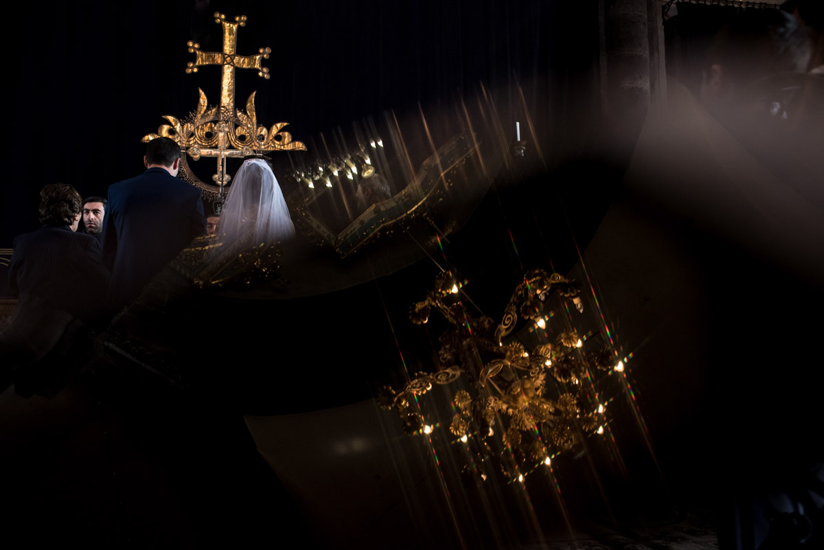 reflection of candelabra and bride and groom during their armenian wedding ceremony