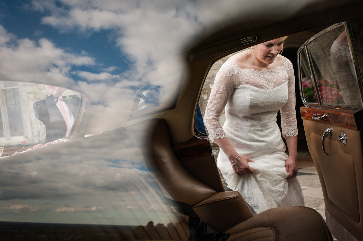 Andrea gets into wedding car after wedding ceremony at Boughton Monchelsea Place in Kent