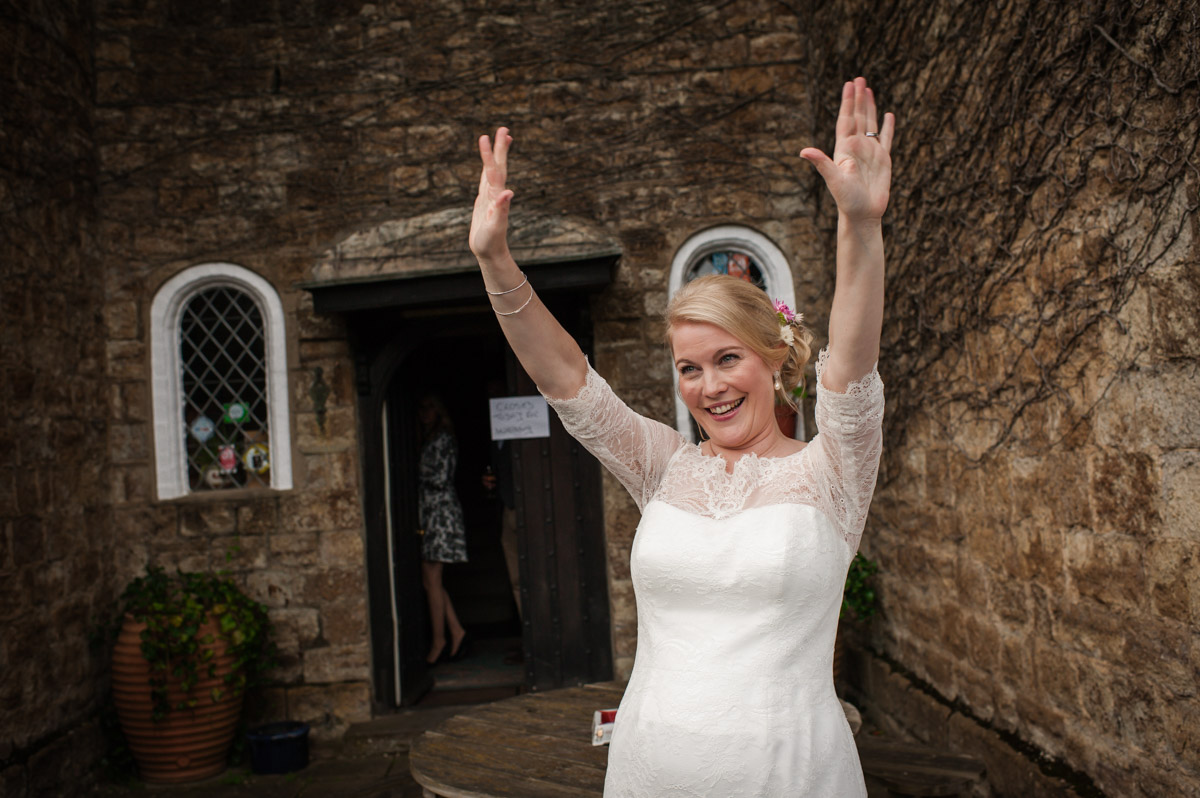 Andrea is photographed waving at arriving guests to reception at Dering Arms in Kent