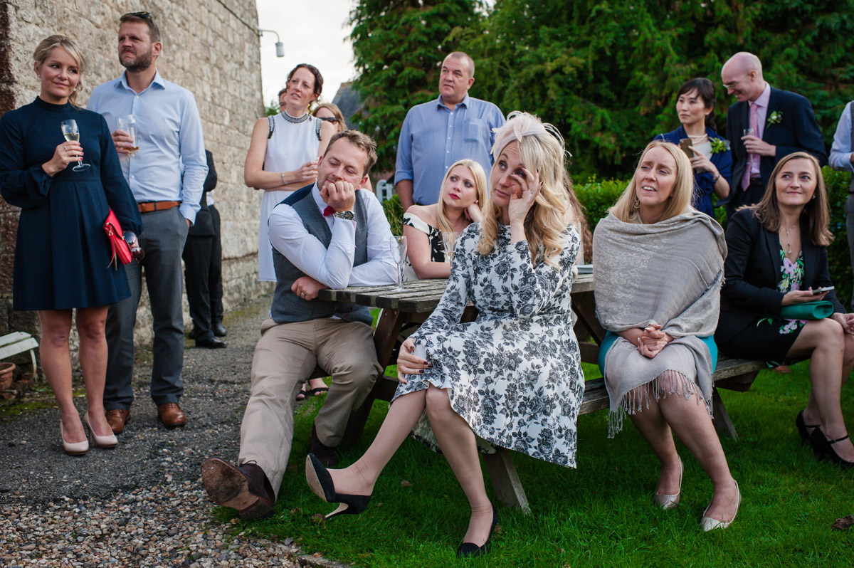 Guests cry at Matthew and Andreas wedding speeches at reception in Kent