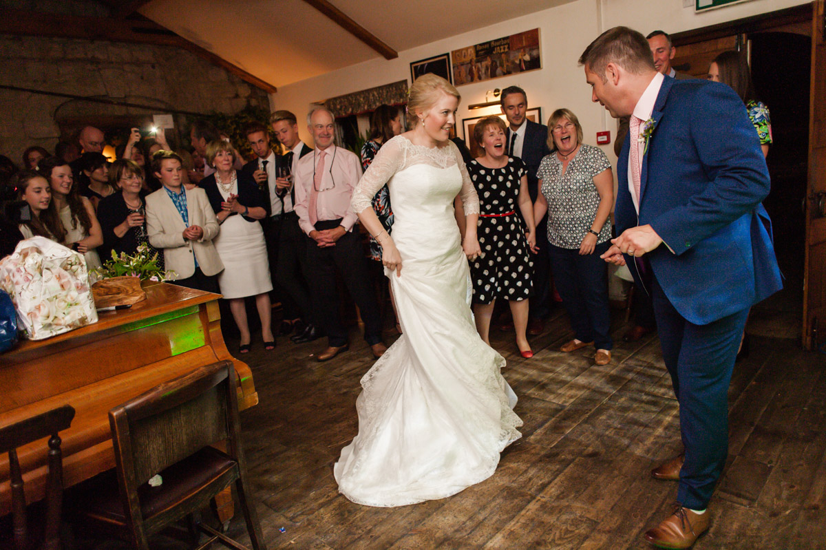 Andrea and Matthew photographed doing first dance at their Kent pub wedding reception