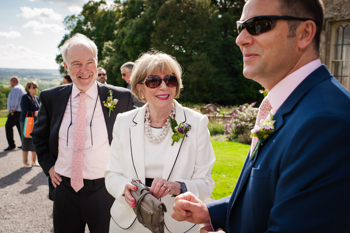 Groom and parents before wedding at Boughton Monchelsea Place in Kent