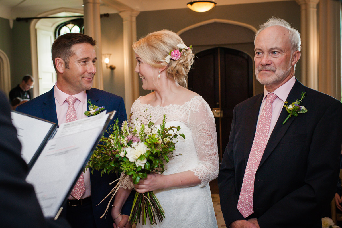 Photograph of Bride and Groom getting married inside at Boughton Monchelsea Place in Kent