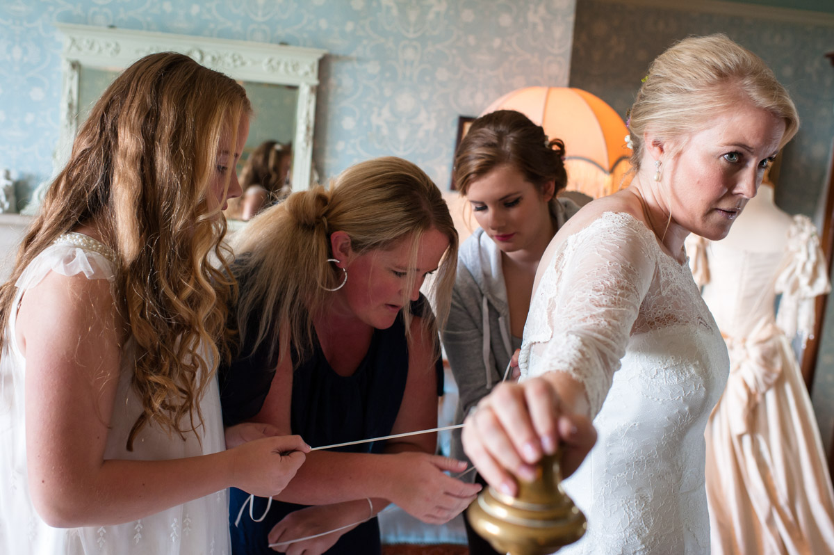 Andrea and bridesmaids photographed getting ready at Boughton Monchelsea Place in kent