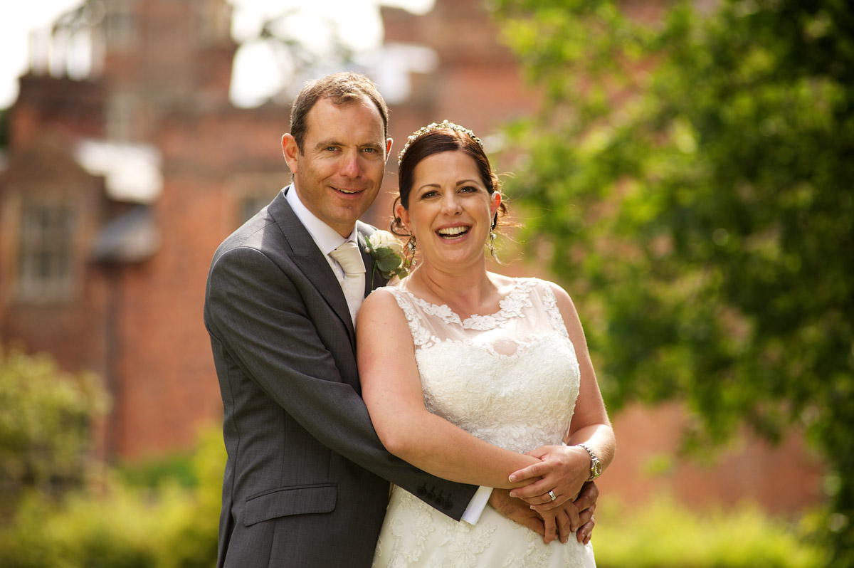 wedding photograph of tim and andrea on their wedding day posing outside cobham hall