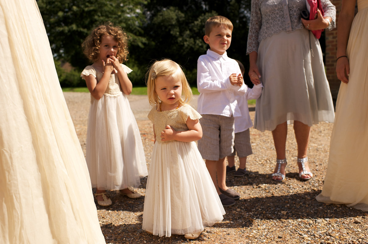 Flower girls and page boy wait for the start of andrea and Tims wedding at cobham hall in kent