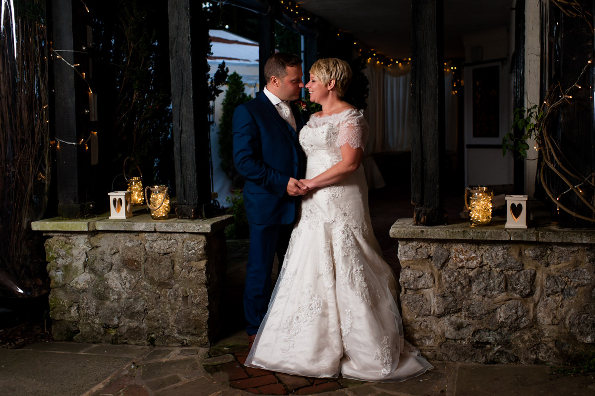Off camera flash lit photograph of bride and groom at Hayne Barn House