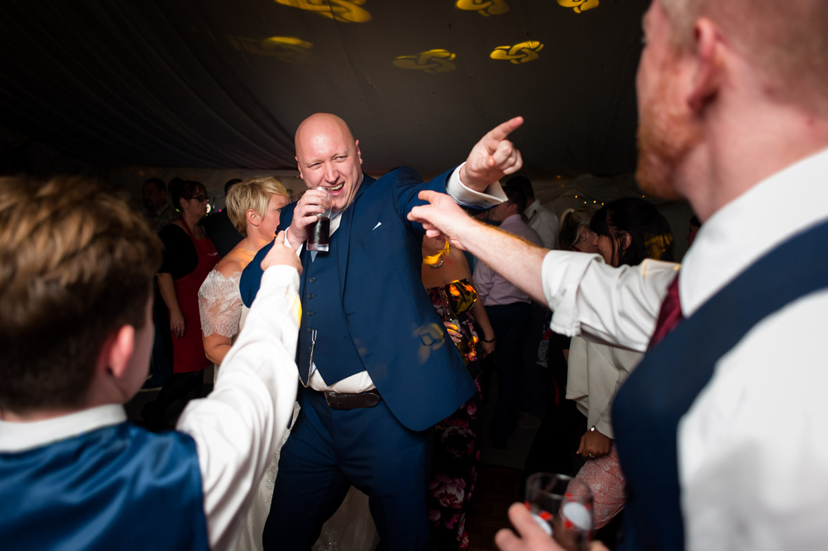 Photograph of wedding guesyts on dance floor at Kelly and Stuarts Hayne Barn House wedding