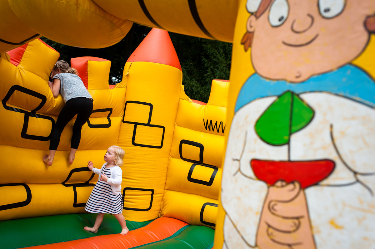 Bouncy castle in garden at Hayne Barn House wedding venue