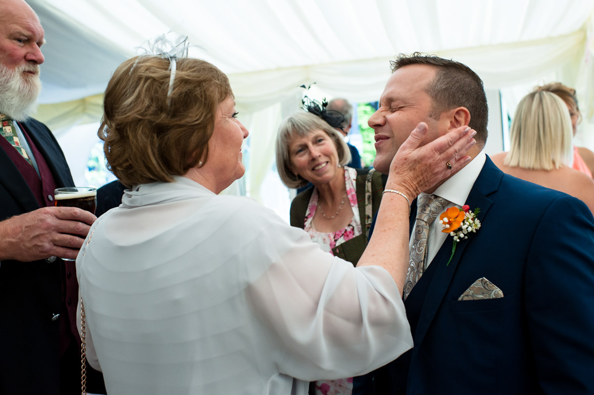 Groom and mum in Hayne Barn House marquee