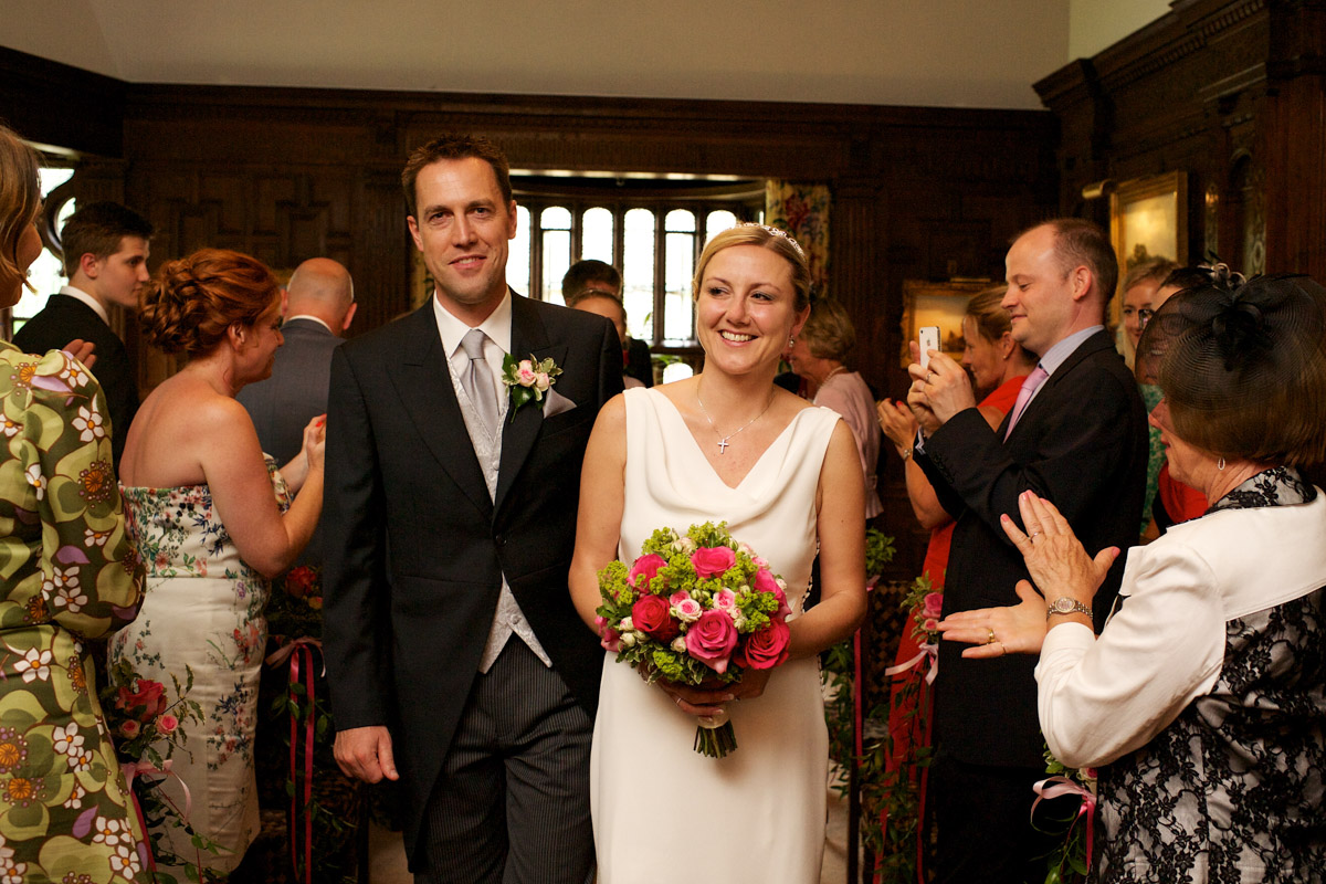 gail and john walk down the sale after their wedding ceremony at hever castle in kent
