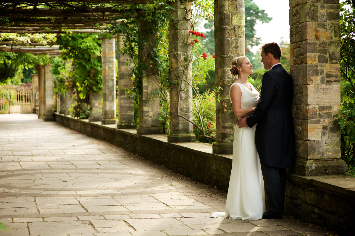 john and gail are photographed together in the italian gardens at never castle after their wedding ceremony