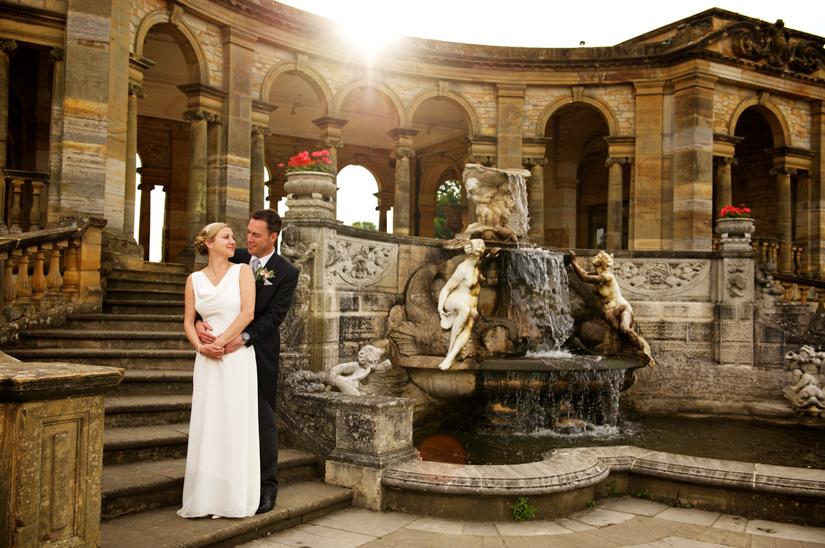 photograph of gail and john by the fountain in the italian gardens at hever castle after their wedding ceremony