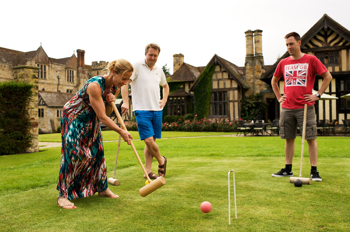 photograph of john playing croquet in ever castle grounds before his wedding ceremony