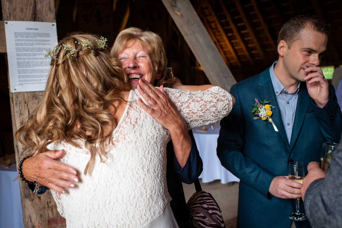 wedding photography at rats bury Barn, guests and Corinne celebrate