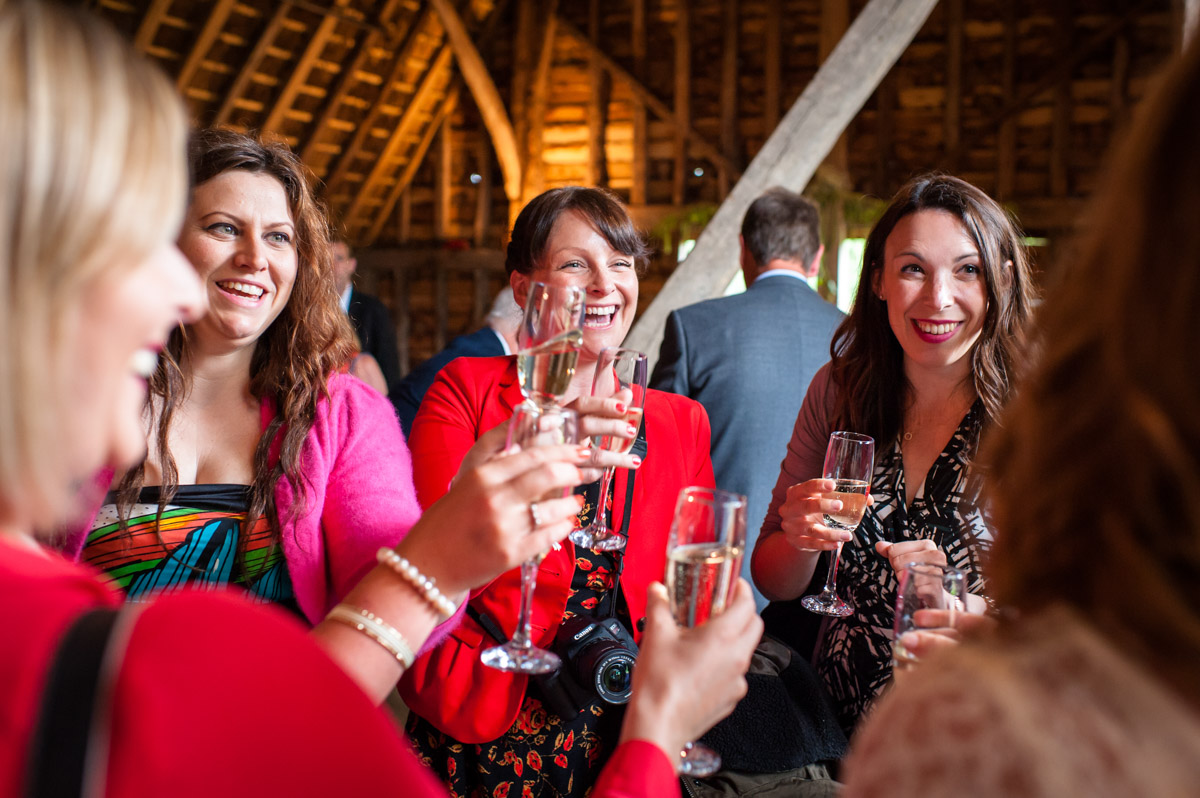 Wedding guests are photographed congratulating Corinne at her wedding at Ratsbury Barn in Kent