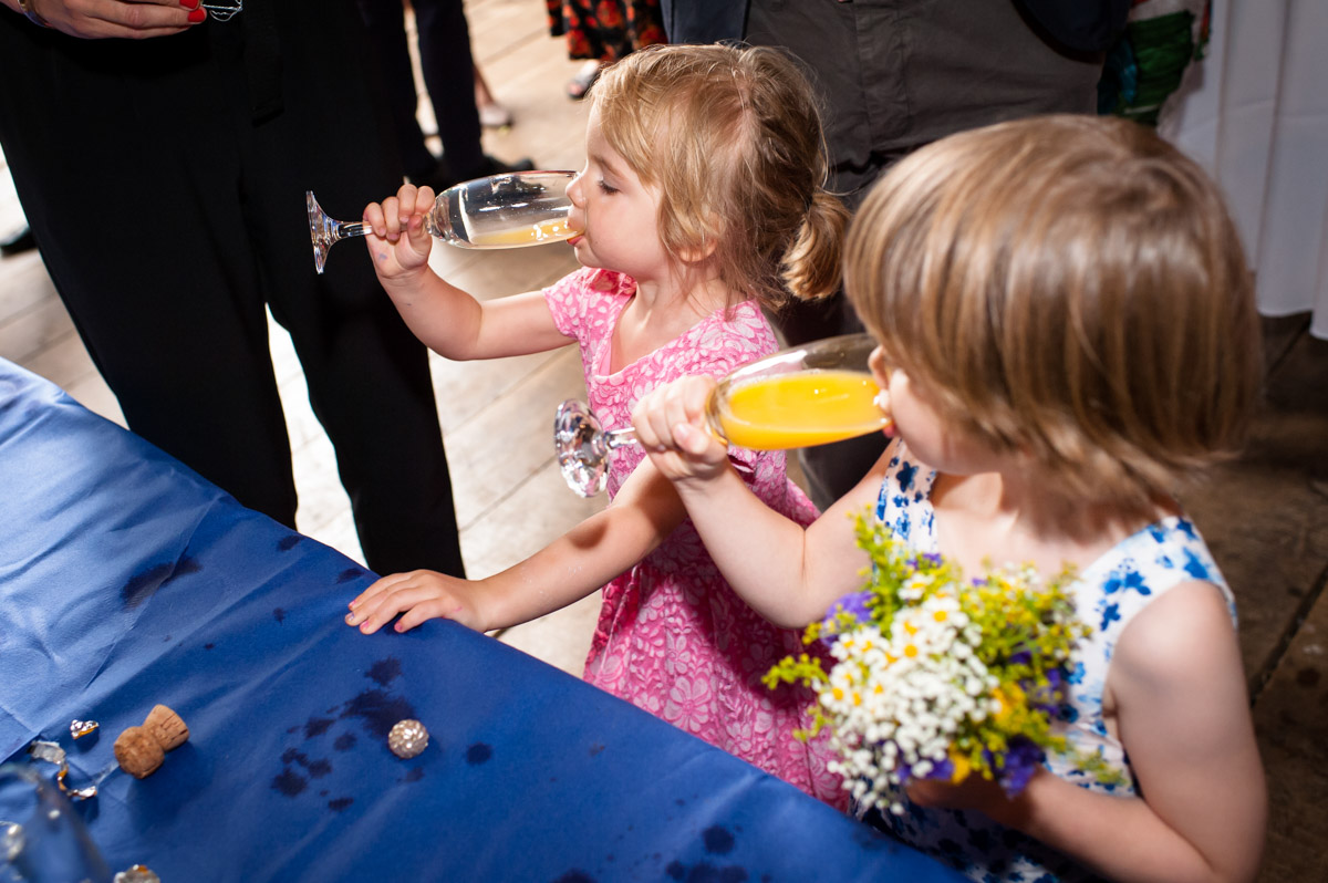 Children drink juice at Ratsbury barn wedding in Kent
