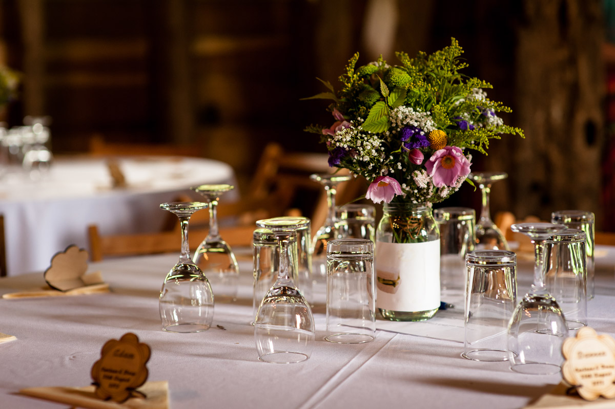 Table decorations at Corinne and Dougs wedding at Ratsbury barn in Tenterden, Kent