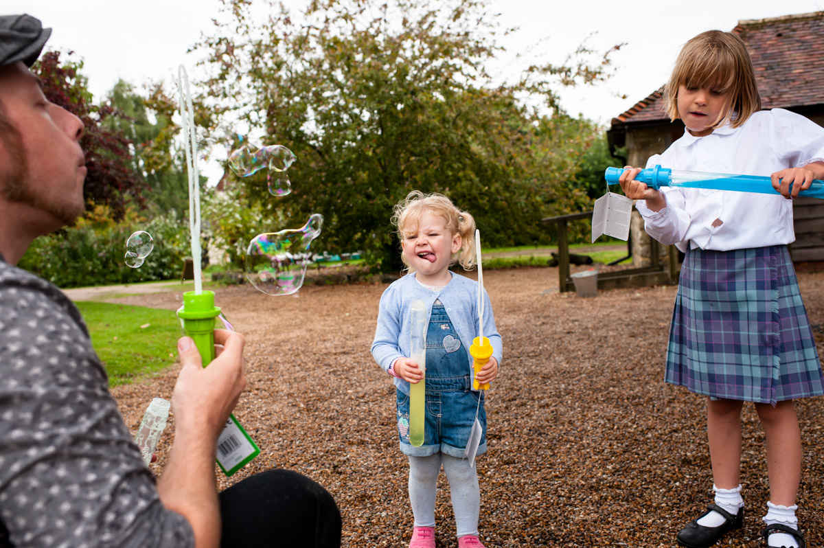 Girl, bubbles, wedding reception, Ratsbury barn, Kent, wedding photography