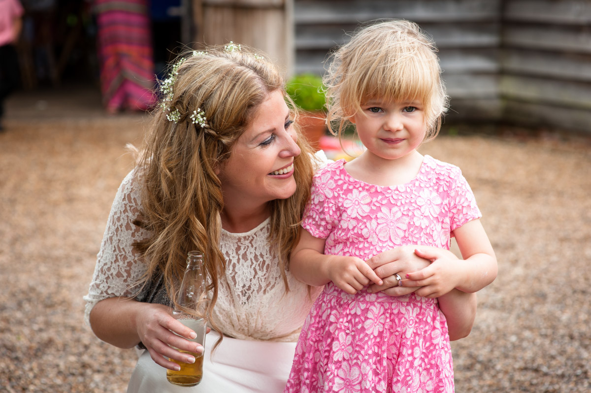 Little girl and bride at Ratsbury barn in Kent