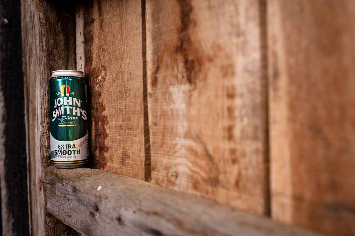 can of lager at Ratsbury barn placed on wooden door during wedding reception