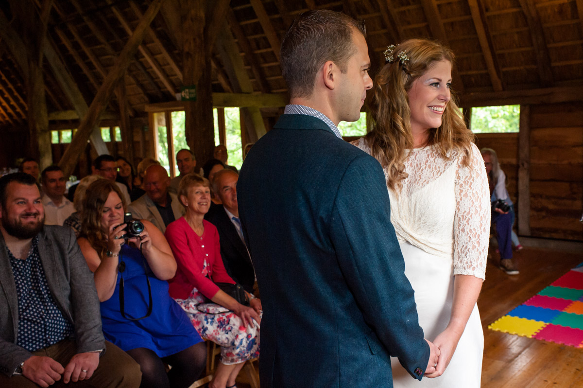 Photograph of Doug and Corinne taking their wedding vows at rats bury Barn in Kent