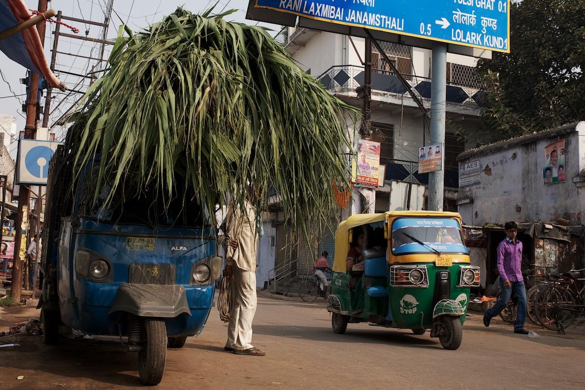 Street photography in Varanasi, man and tuk tuk
