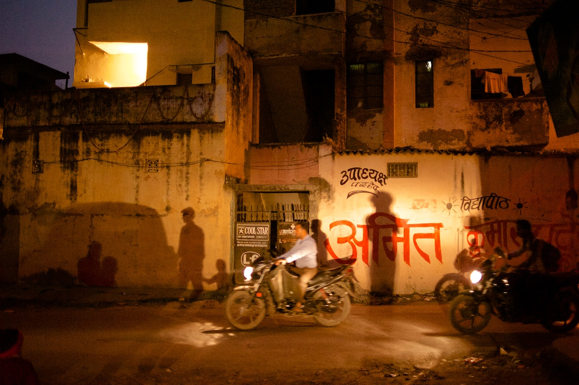 Photograph of my shadow and motorbike in India at night