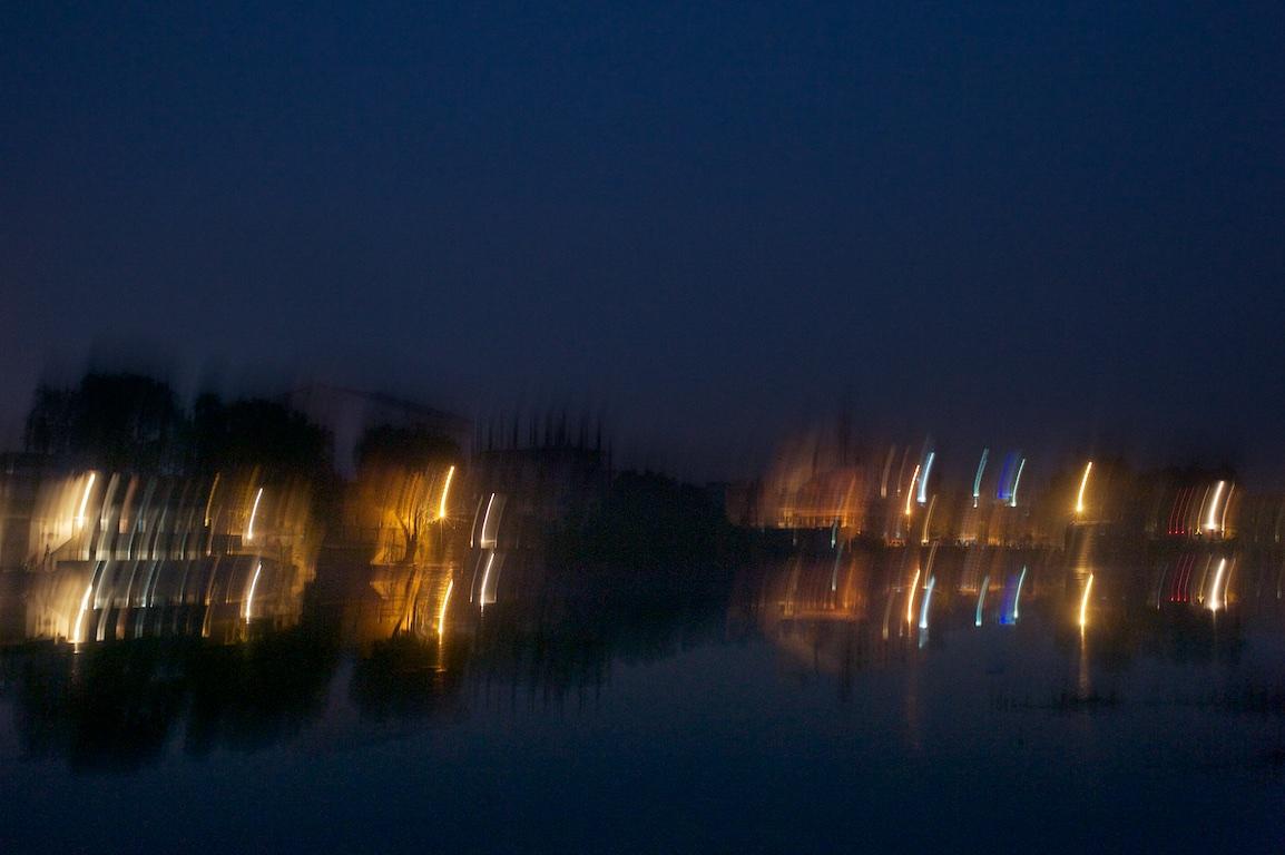 Blurred image of lake in Varanasi, India at night