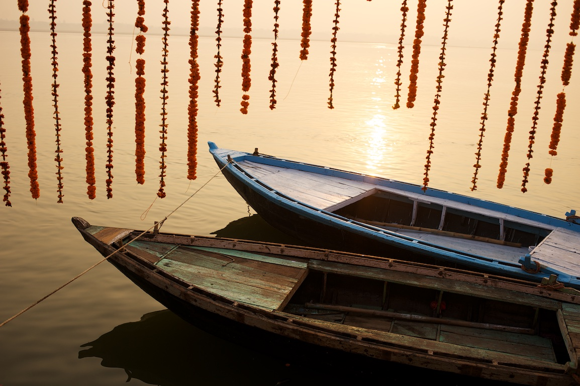 photograph of boats on ganges river in varanasi