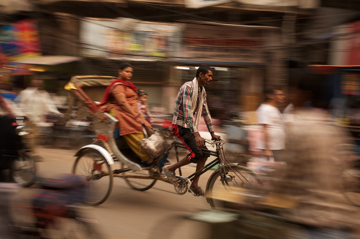 Photograph of rickshaw and female passenger