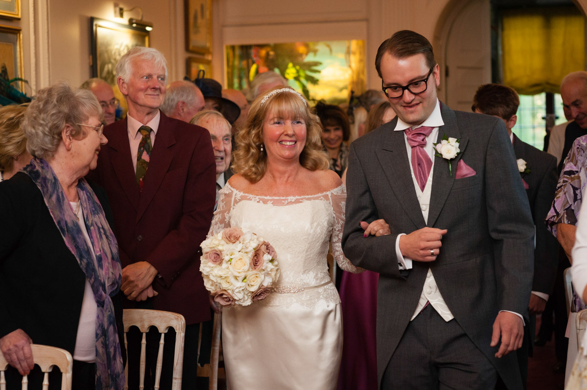 Martine is walked down the aisle by her son on her wedding day at Port Lympne Mansions in Kent