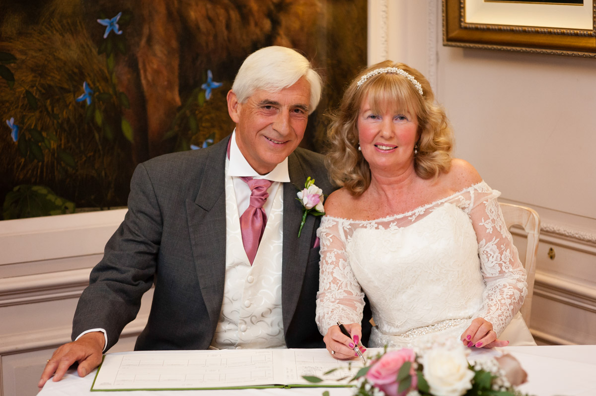 Martine and Dick photographed after signing the register after their kent wedding ceremony