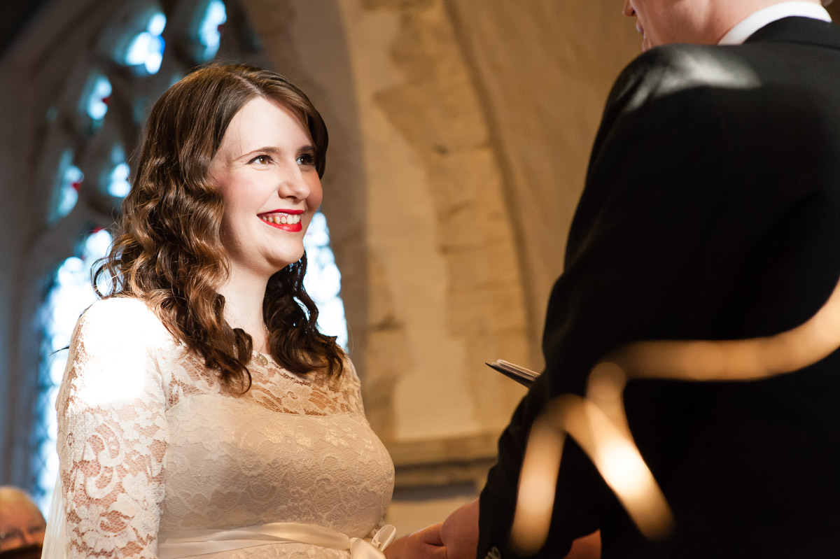 charlotte looks at mark during their kent church wedding ceremony