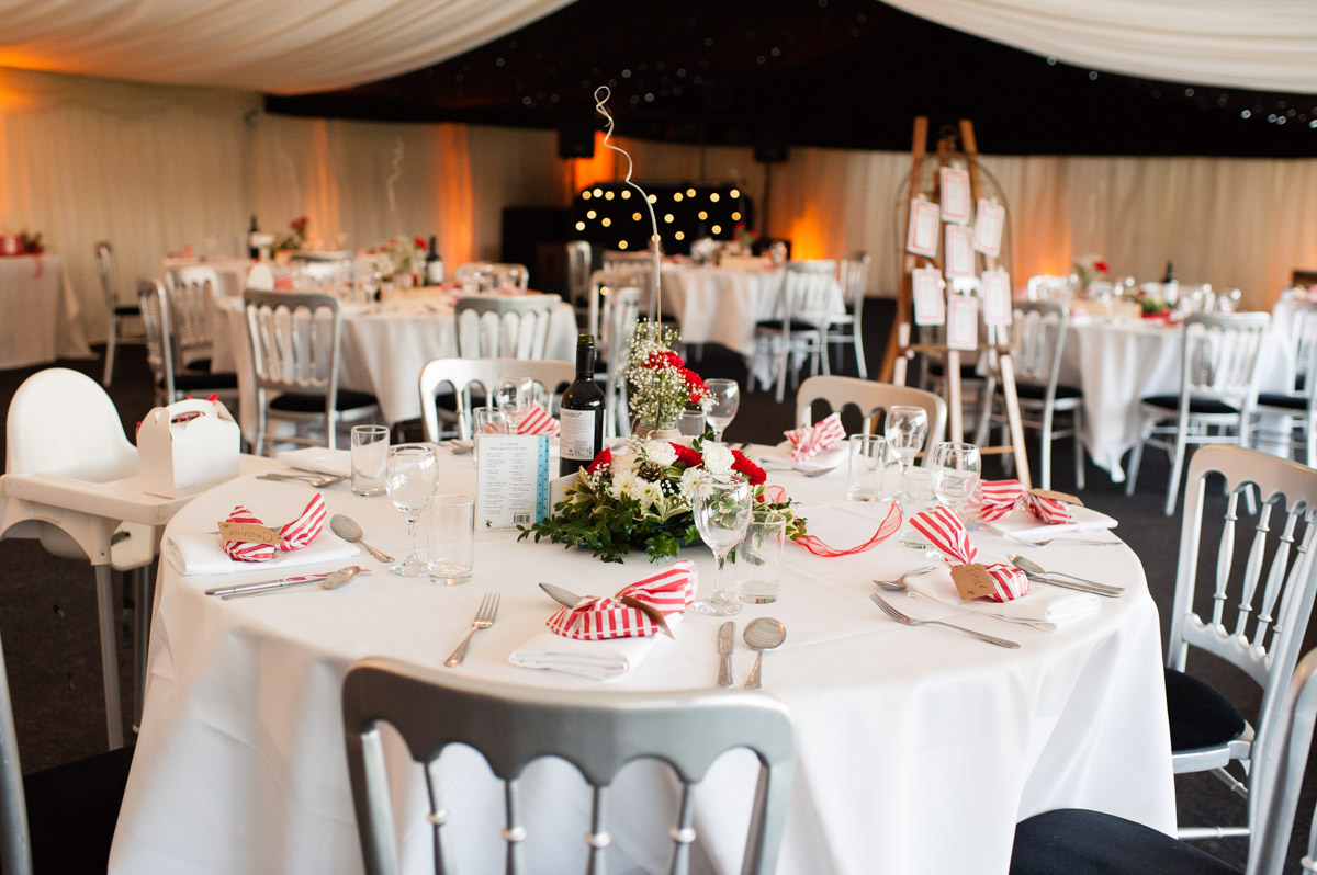 wedding tables and decorations at mark and charlottes wedding reception in marquee at Nursted court in kent