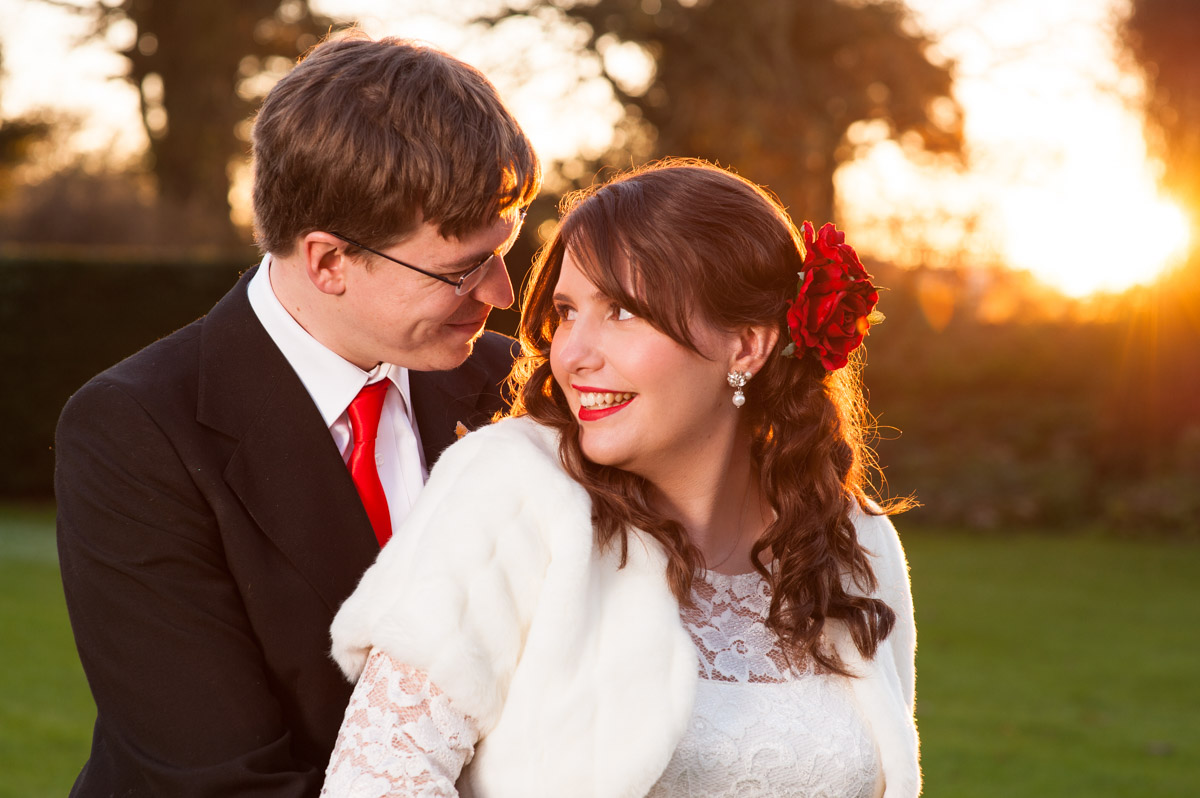 portrait photograph of mark and charlotte outside and sunset at nursed court on their wedding day