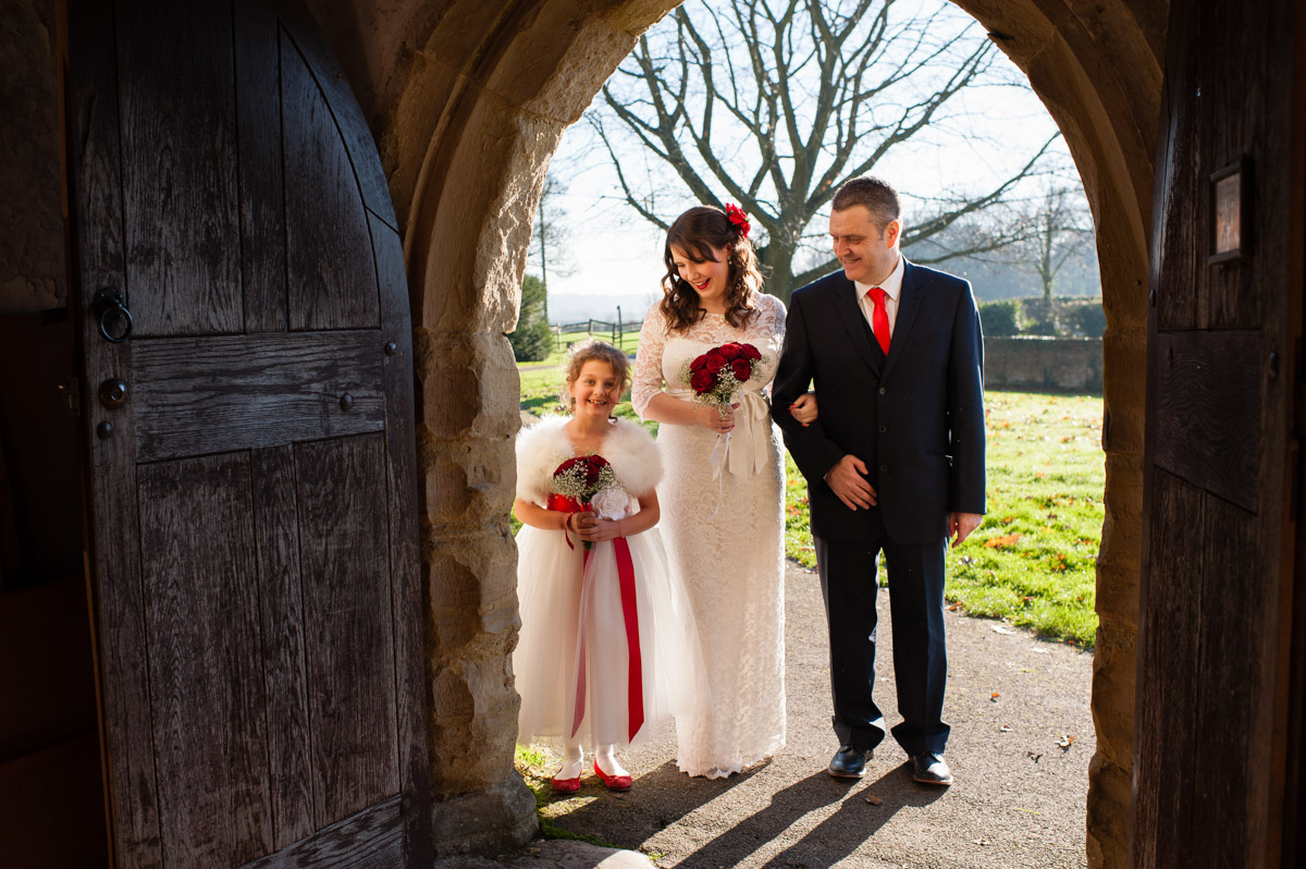 charlotte and her dad and flower girl what to enter church for her wedding ceremony to mark