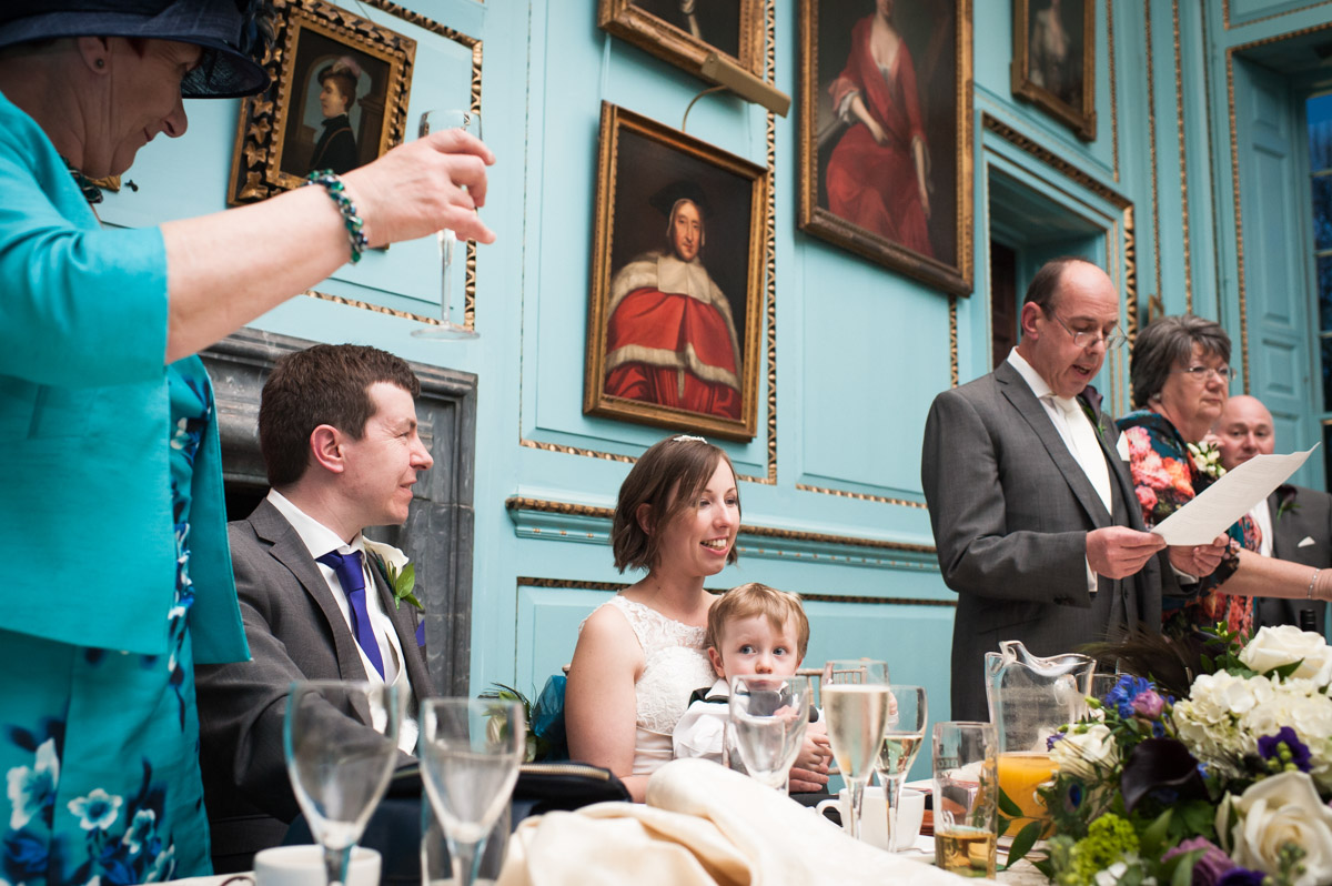 Guests toast the newly weds during their reception in The Great hall at Bradbourne House
