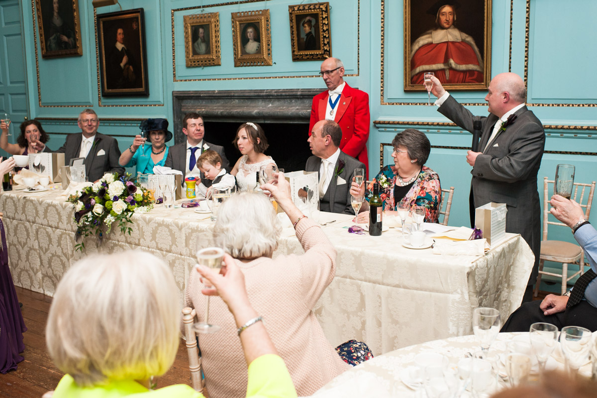 Best man toasts the bride and groom after his speech at Bradbourne House