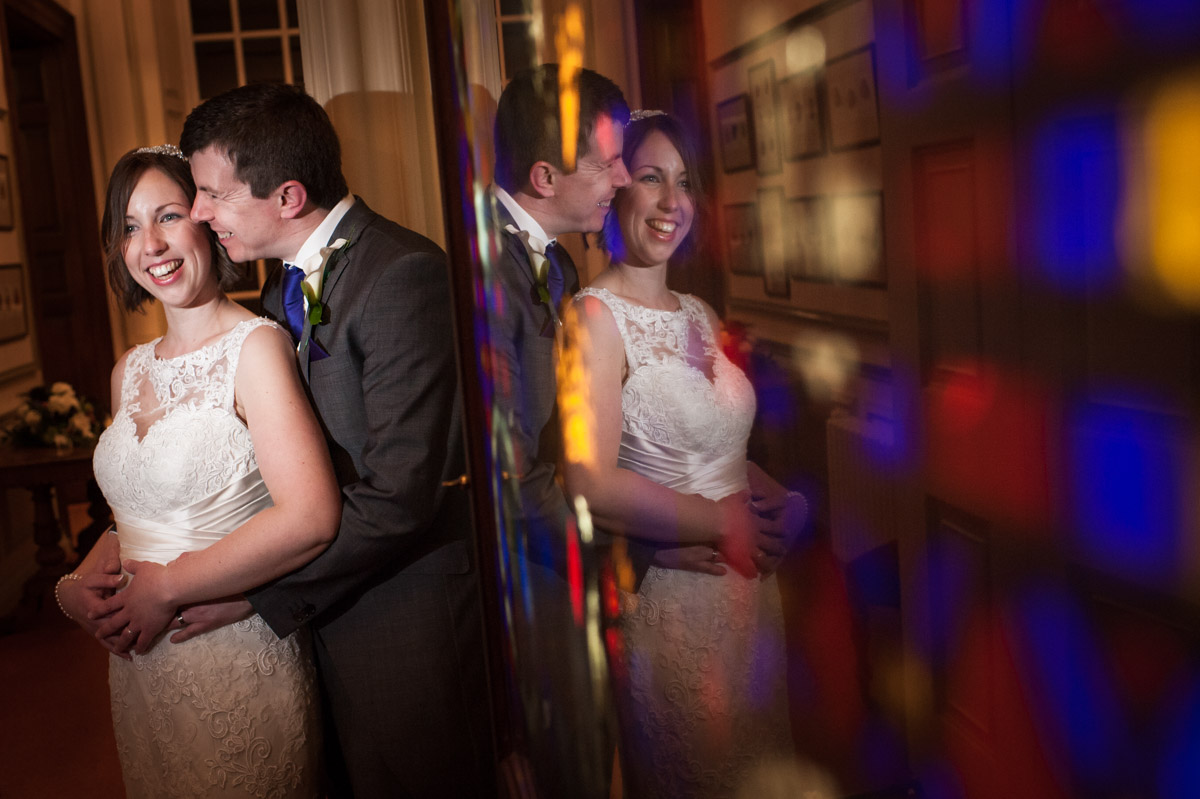 Photograph of Liz and Simon reflected in picture at their wedding at Bradbourne House in Kent