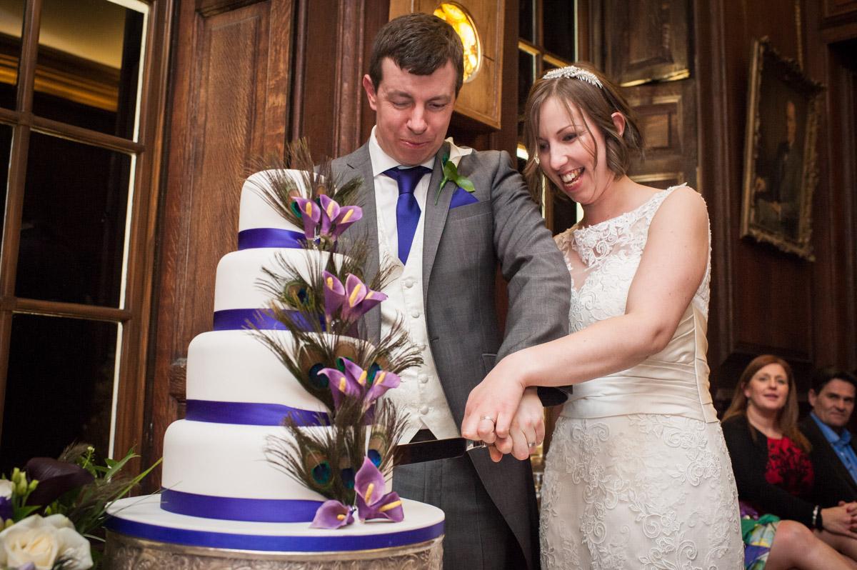 Bride and groom cut their wedding cake at Bradbourne House