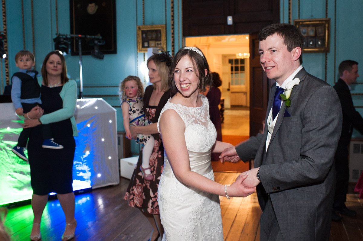 The bride and groom enjoy their first dance before wedding guests join them on the dance floor